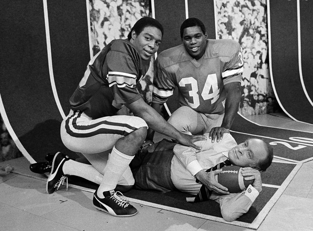 Heisman Trophy winner Marcus Allen and 1981 runner-up Walker pose with Bob Hope at NBC Studios in Burbank, Calif. After two straight seasons finishing in the top three in voting, Walker won the award in 1982. (He  was third in 1980 after setting a NCAA record for rushing yards as a freshman.)