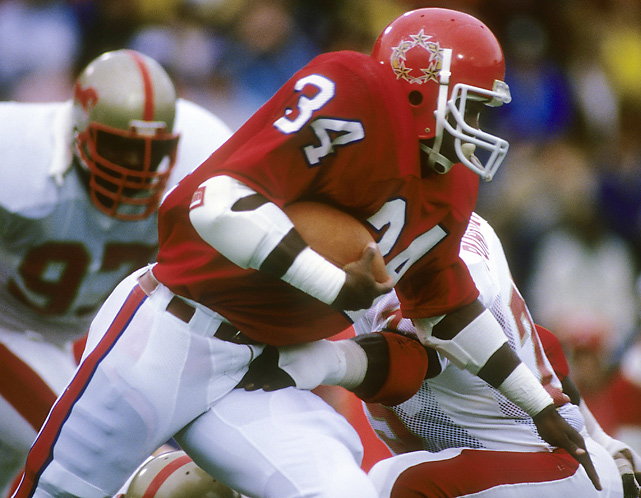 Walker evades a tackle during a New Jersey Generals game against the Birmingham Stallions. Walker played for the Generals from 1983 to '85. He chose to play in the USFL because he wanted to come out of college after his junior season, which the NFL forbid at the time.
