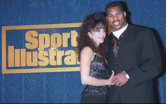 Walker and his then-wife Cindy Grossman pose at a party celebrating the  Sports Illustrated swimsuit edition in New York. This marked the first time the SI swimsuit edition featured athletes and their spouses.