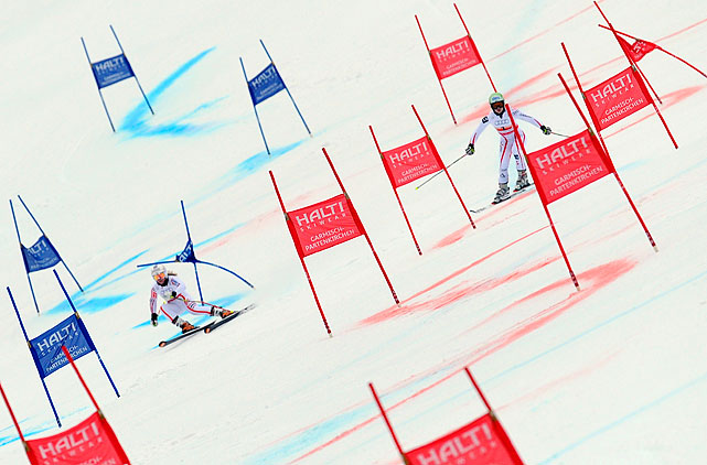 Tessa Worley of the winning French squad (left) competes against Anna Fenninger of Austria during the FIS Alpine World Ski Championships Nations Team event in Garmisch-Partenkirchen, Germany.