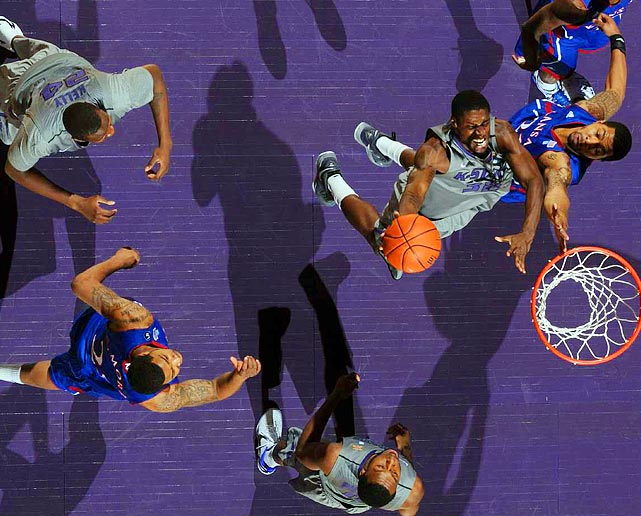 Kansas State forward Jamar Samuels drives to the hoop on Kansas forward Markieff Morris as the two rivals met at Bramlage Coliseum on Feb. 14.  The Wildcats defeated the top-ranked Jayhawks 84-68, who fell to No. 3 with the loss.