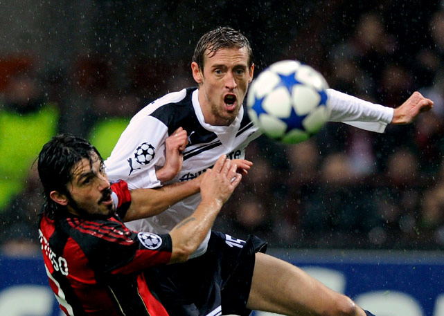 Gennaro Gattuso of AC Milan and Peter Crouch of Tottenham Hotspur compete for the ball during the UEFA Champions League round of 16 first leg match between AC Milan and Tottenham Hotspur at Stadio Giuseppe Meazza on Feb. 15, in Milan.