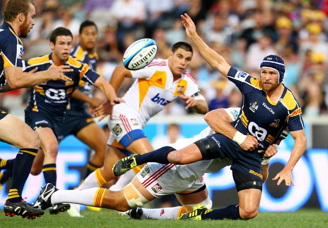 Matt Giteau of the Brumbies offloads during a Super Rugby match between against the Chiefs at Canberra Stadium on Feb. 19 in Canberra, Australia.