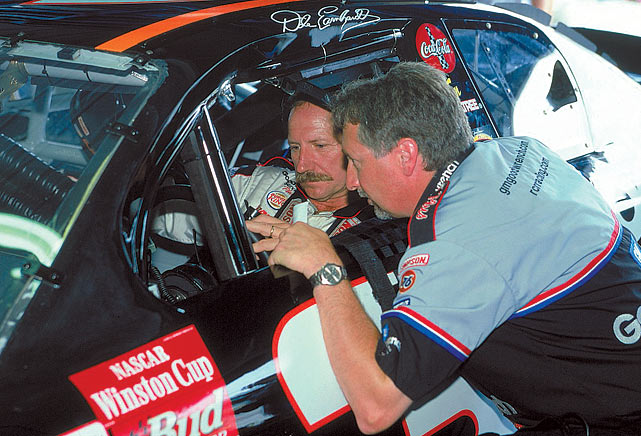 Dale Earnhardt and crew chief Kevin Hamlin talk in the garage at Daytona Speedway prior to the Pepsi 400.