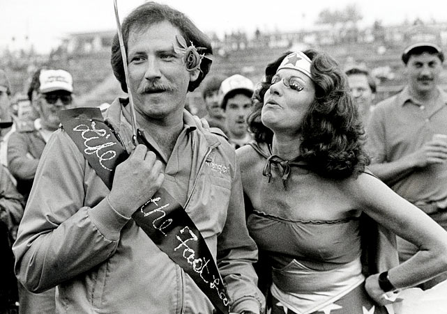 A female fan dressed as Wonder Woman looks for a smooch from Dale Earnhardt at the Sovran Bank 500.