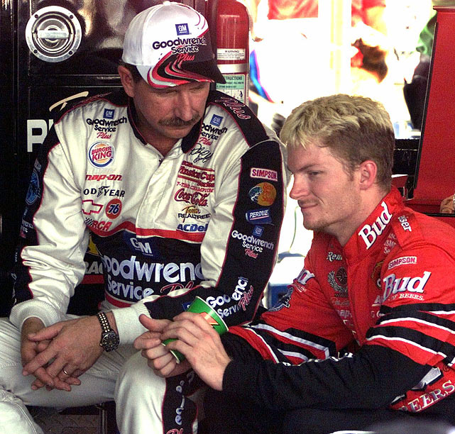 Earnhardt and son Dale prep for the Southern 500 at Darlington Raceway. The duo are one of only a handful of father-son racers to compete in the same event.
