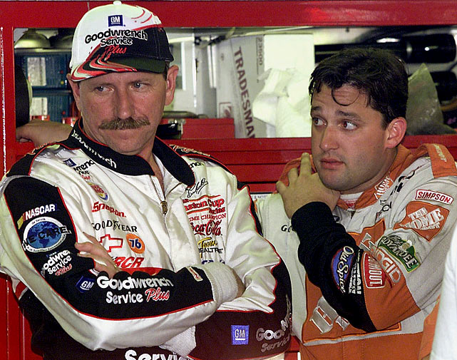 During a practice session for the UAW-GM Quality 500 at Lowe's Motor Speedway, Earnhardt and Tony Stewart speak in the garage. It would be less than a year later that both Earnhardt and Stewart were in accidents during the Daytona 500.