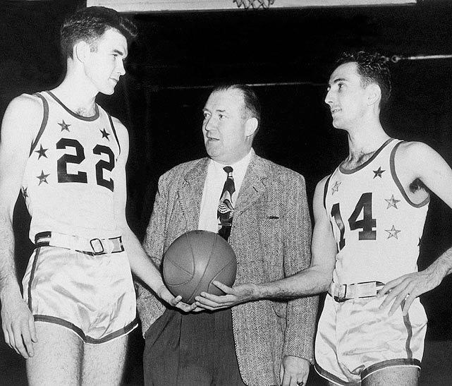 "The 6-foot-1 ""Houdini of the Hardwood"" (right) averaged 15.6 points, 6.9 rebounds and 4.9 assists in his first NBA season. He was named to his first of 13 All-NBA teams that year and was selected to the league's first All-Star Game, in 1951, along with teammate Ed Macauley (left), helping the East to a 111-94 victory. Boston's Cousy went on to win six NBA championships, an MVP award and eight of the league's first 11 assist titles to earn a legacy as the game's first great point guard."
