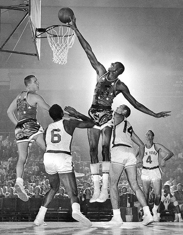 In front of his hometown crowd, Wilt Chamberlain, then only a rookie, led the East to a 125-115 victory in Philadelphia.  Chamberlain scored 23 points and pulled down 25 rebounds.