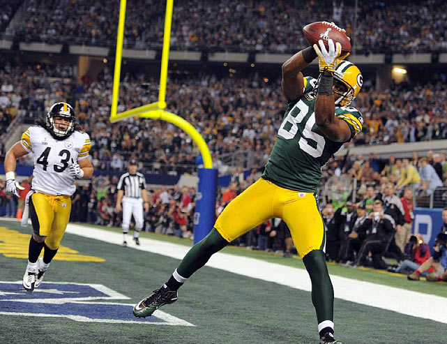 Packers wide receiver Greg Jennings catches his second touchdown of the game to put Green Bay up 28-17 in the fourth quarter.
