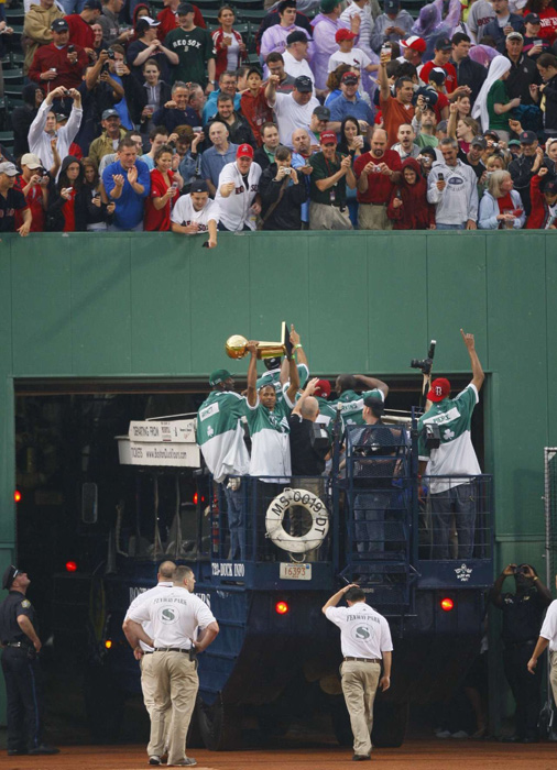 Allen proudly display's the NBA Championship trophy as he and the Celtics are honored by Boston Red Sox fans at Fenway Park.