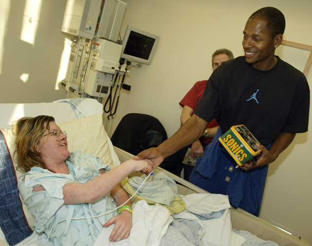 Allen pays a visit to a young patient at the Children's Hospital on Dec. 18, 2003, in Seattle.