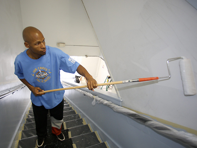 "Allen applies paint to the walls of Laurel Elementary School during the Day of Service during All-Star Weekend in New Orleans. Allen has been an active member of the community during his career; he started the ""Ray of Hope"" Foundation in 1997 to aid a number of sports-related and community-based charities."