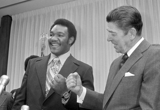 Heavyweight boxing champ George Foreman and California Governor Ronald Reagan compare fists in the governor's office in Sacramento.