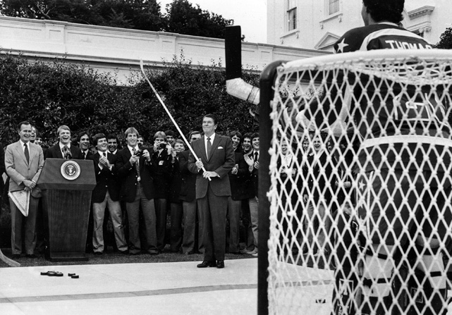 Reagan reacts after scoring against USA Olympic team goalie Bob Mason during a ceremony at the White House Rose Garden for members of the 1984 U.S. Olympic team.