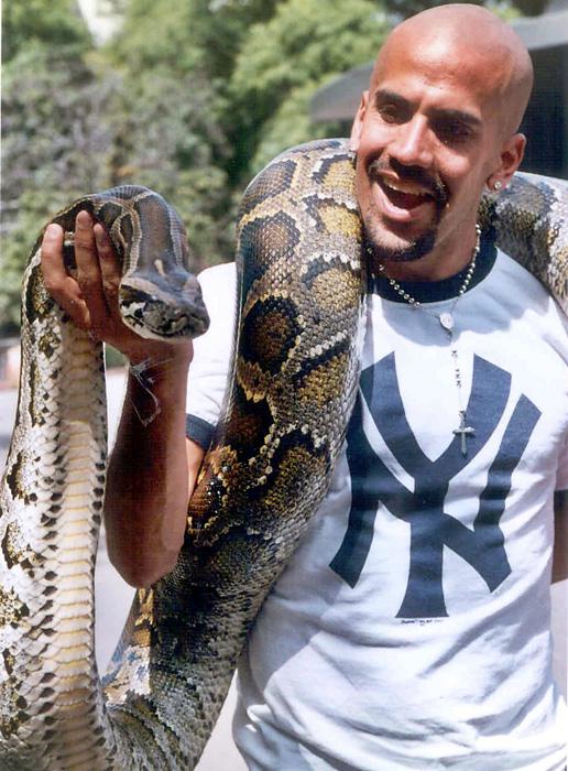 Argentine soccer player Juan Sebastian Veron plays with a python during a trip to the Buenos Aires Zoo.
