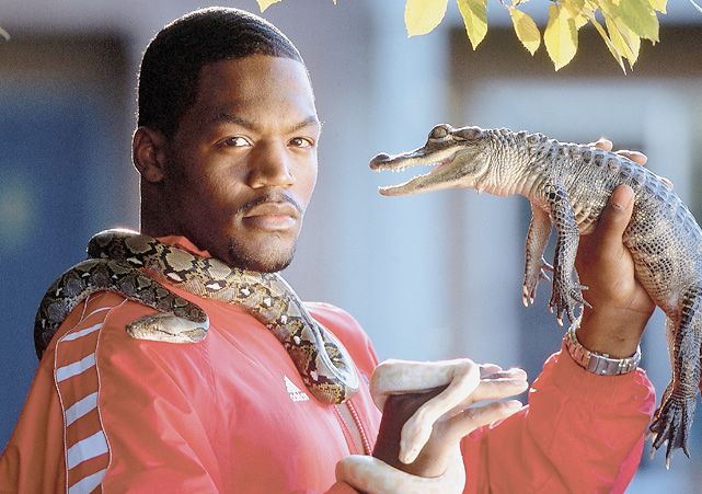 Former Louisville running back Tony Stallings poses with his pet snake and alligator during a 2001 SI photo shoot.