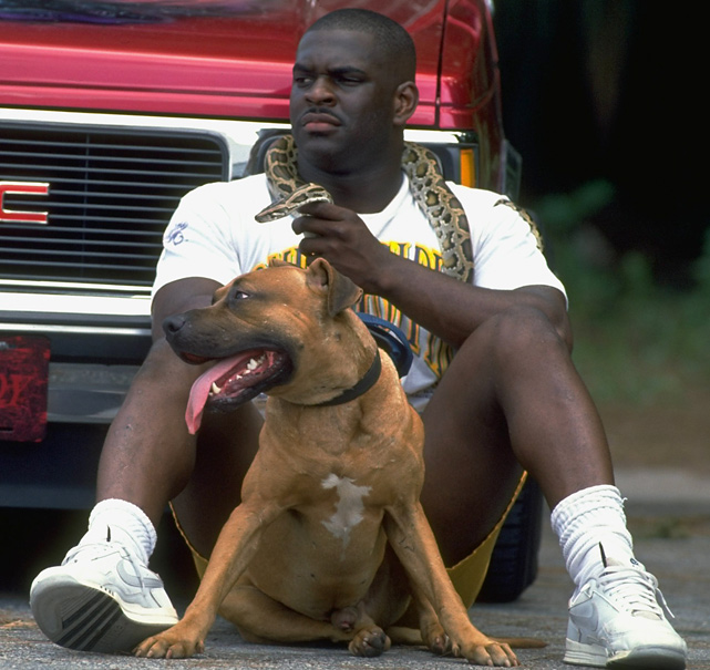 Gators RB Errict Rhett poses with his snake and dog during a 1992 SI photo shoot.