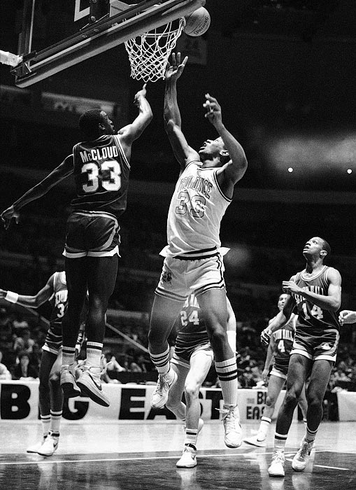 Seton Hall's Andre McCloud successfully swats the ball from the fingertips of Otis Thorpe during a 1984 qualifying Big East tournament game.