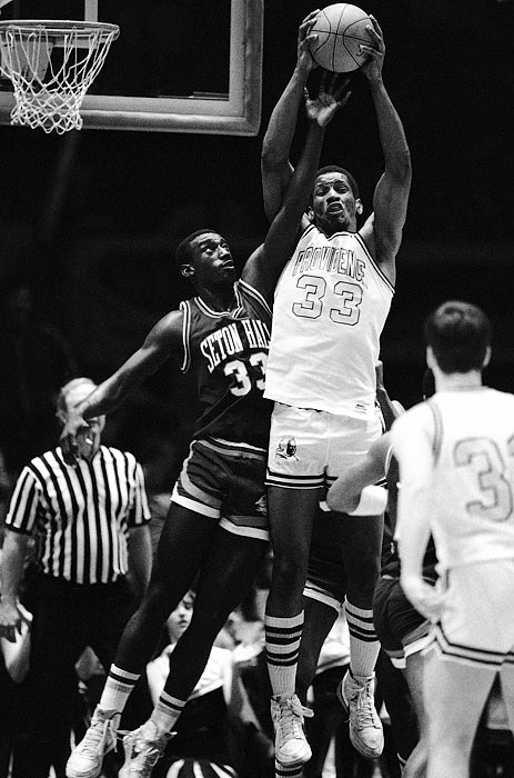 Otis Thorpe of Providence soars to grab a rebound over Andre McCloud of Seton Hall during a qualifying game for the 1984 Big East tournament. Providence defeated Seton Hall and advanced.