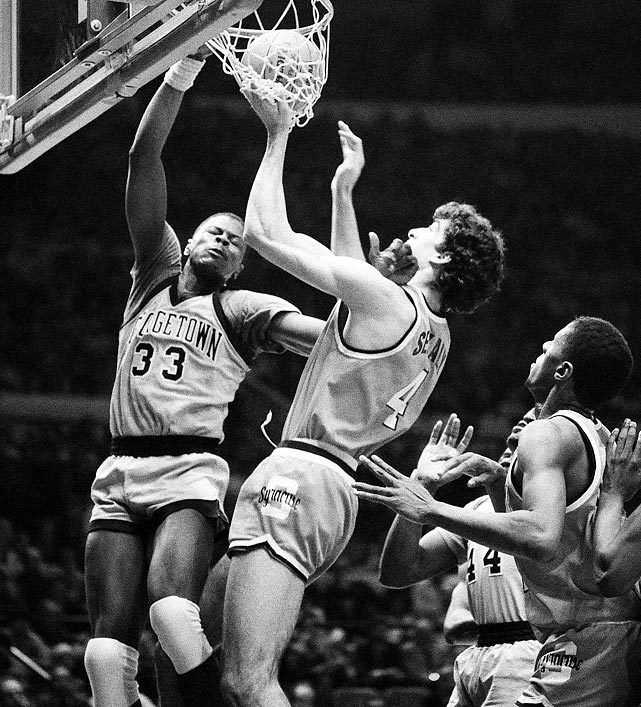 Patrick Ewing (33) ferociously dunks over Syracuse's Rony Seikaly during the semifinals of the 1985 Big East tournament. Ewing would go on to win the tournament's Most Valuable Player award and would lead Georgetown to a Big East Championship and appearance in the NCAA tournament finals.