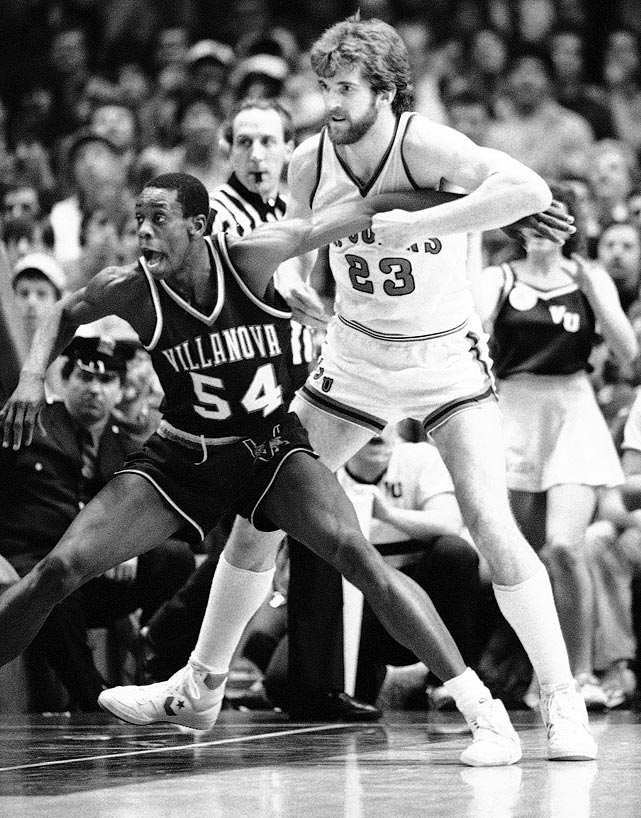 Villanova's Ed Pinckney (54) posts up St. John's Bill Wennington during an 89-74 loss. St. John's fell to Georgetown in the conference finals.