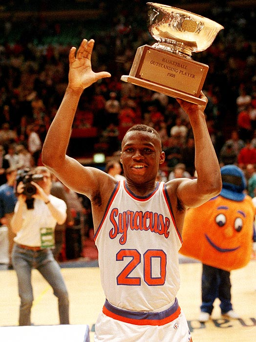 Syracuse point guard Sherman Douglas proudly holds up the Most Valuable Player trophy after averaging 20 points in three games. The Orangemen beat Villanova 85-68 on March 13, 1988, to win the tourney.