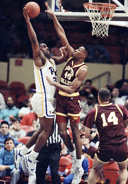 Pittsburgh forward Darren Morningstar attempts a dunk against Boston College's Reggie Pruitt in the opening round of the 1990 Big East tournament. Pittsburgh beat Boston College 88-70 but ended up losing in the next round.