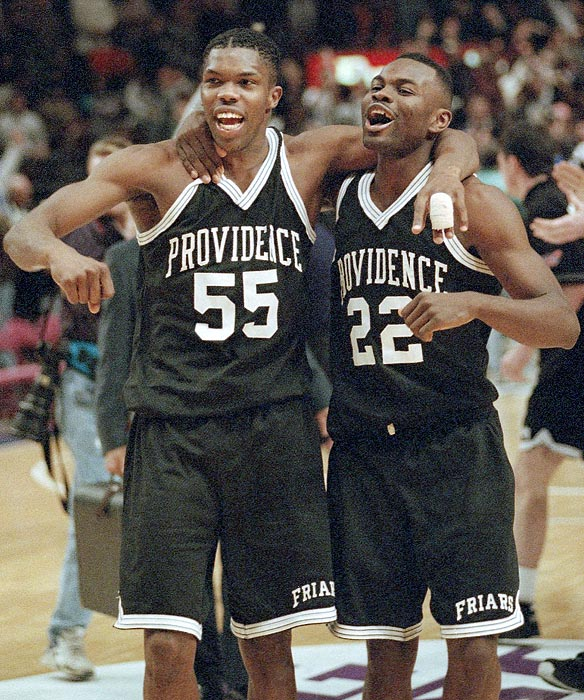 Providence forward Eric Williams (55) and guard Rob Phelps (22) embrace after knocking off the top-seeded Connecticut Huskies in the semifinal round of the 1994 Big East tournament. The Friars beat UConn 69-67 and proceeded to win the entire tournament.