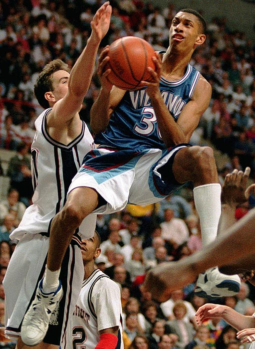 Villanova guard and Big East Player of the Year Kerry Kittles soars past Connecticut's Travis Knight during a 96-73 win over the No. 1 ranked Huskies.