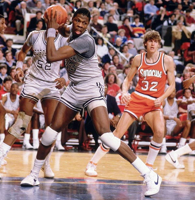 Georgetown center Patrick Ewing (33) wrestles for a rebound against Syracuse forward Andre Hawkins in the Big East finals. Ewing, the eventual MVP of the tourney, carried the Hoyas past the Orangemen in overtime, 82-71.