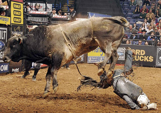 Dusty LaBeth of Louisburg, Kan., goes face first into the dirt after being bucked off by Mo.
