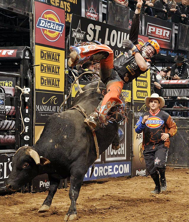2010 Professional Bull Riders Reserve Champion Austin Meier of Kinta, Okla., dismounts after an 82-point ride on Little Crazy.