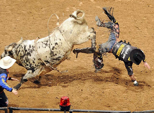 2008 Professional Bull Riders World Champion Guilherme March of Leme, Brazil, dismounts Big Money after scoring 84 points.