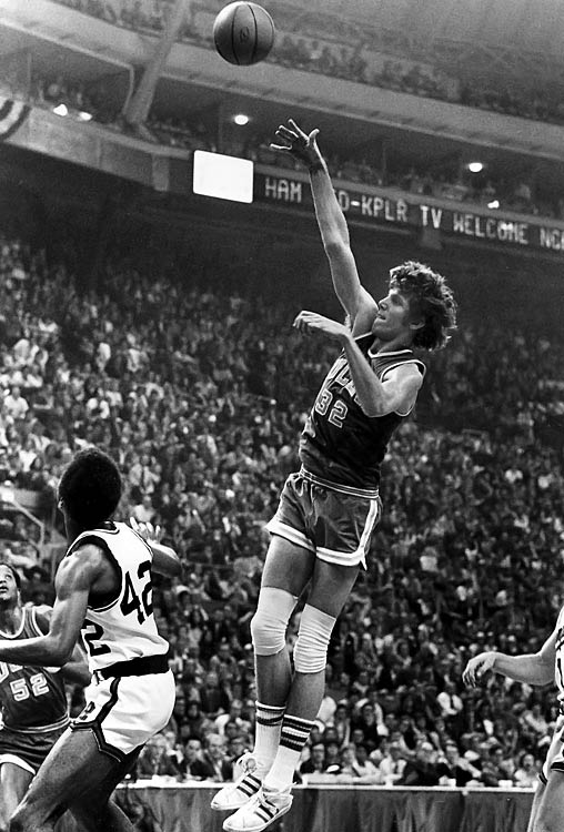 In 1973, Bill Walton of UCLA was one of the biggest forces in the paint, earning him the Naismith Award that year.  Bill Walton proved his worth in 1973 with a near-perfect game in the championship victory against Memphis State.   The junior center poured in 44 points on 21 of 22 shooting to go along with 13 rebounds, one of the greatest individual performances in tournament history. His close to flawless showing in the 87-66 win capped a   30-0 season for the Bruins and coach John Wooden.