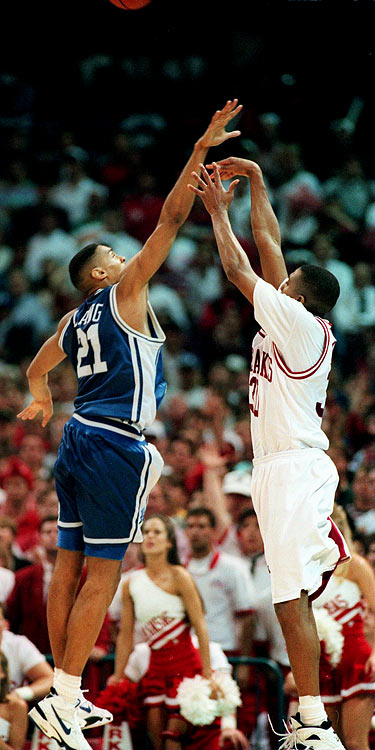 Duke held a 10-point second-half lead over Arkansas, but the Hogs clawed back. With the score tied at 70 apiece and 40 seconds left, Arkansas' Scotty Thurman lofted a high-arching three-pointer over 6-foot-8 Blue Devil Antonio Lang with one second on the shot clock. The looping shot was good and the Hogs went on to win the game 76-72 for the school's first national title.
