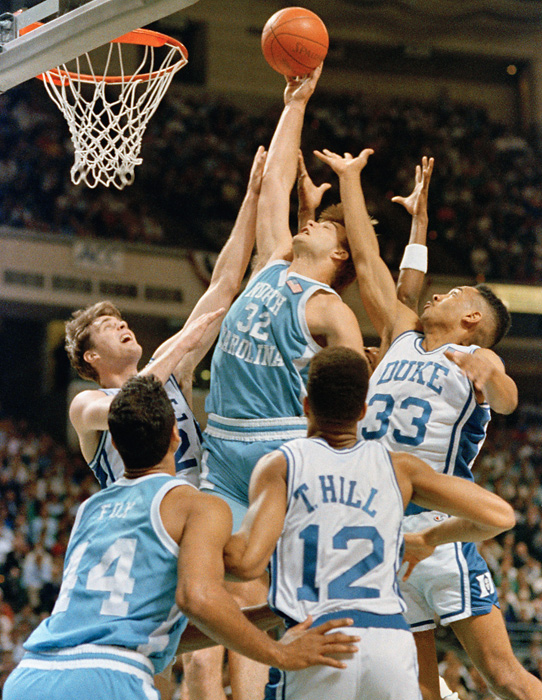 North Carolina forward Pete Chilcutt  rises above Duke's Christian Laettner, left, Thomas Hill and Grant Hill during the tournament final against Duke. The Tar Heels won 96-74.