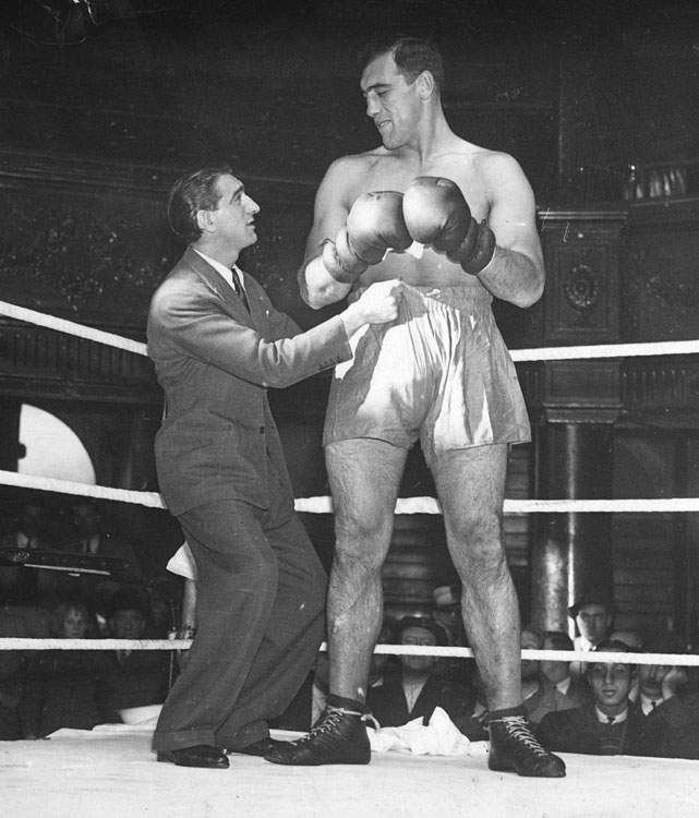 """The Ambling Alp"" stopped Jack Sharkey in the sixth round to win the world heavyweight title on June 29, 1933."