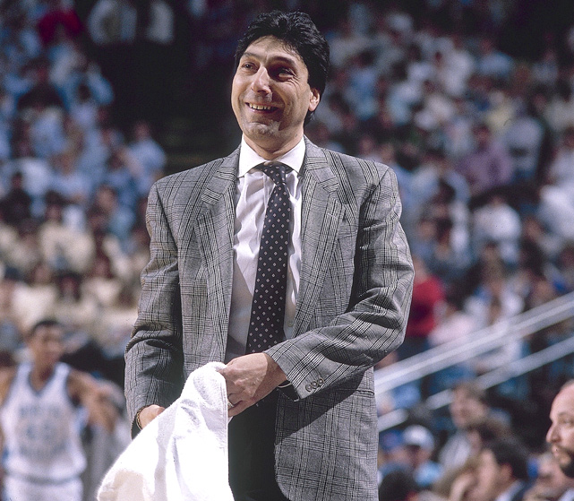 Valvano smiles from the sideline during a game against North Carolina. The coach posted a 209-114 record in 10 seasons with the Wolfpack, including seven appearances in the NCAA tournament.
