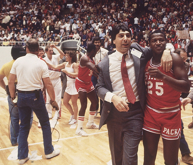 Moments after winning the national title, Valvano embraces Dereck Whittenburg, who threw up the last-second airball that was caught by Lorenzo Charles for the game-winning dunk.