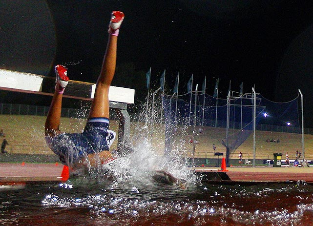 Australia's Emma McKinney falls during the U17 2000-meter steeplechase at the Australian junior athletics championships on March 10.