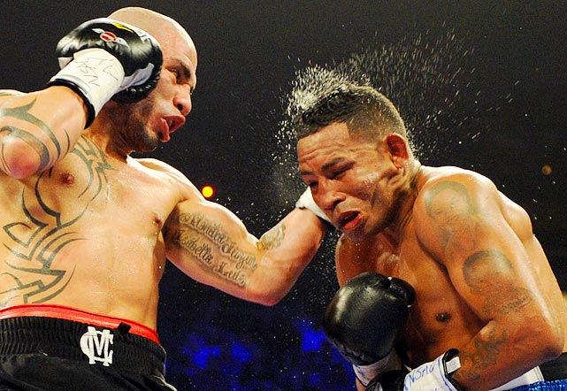 Miguel Cotto lands a punch on Ricardo Mayorga before defeating him by TKO during their WBA super welterweight title fight in Las Vegas on March 12.