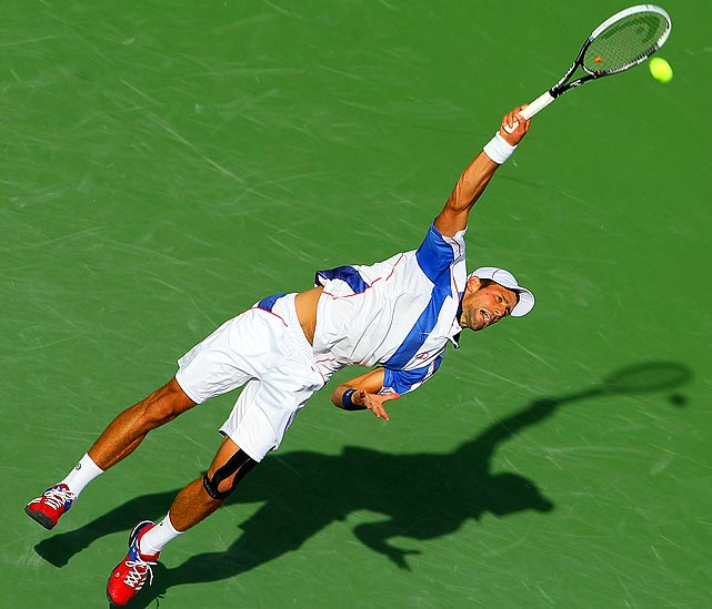 Novak Djokovic serves to Viktor Troicki during the BNP Paribas Open in Indian Wells, Calif. Djokovic won 6-0, 6-1.