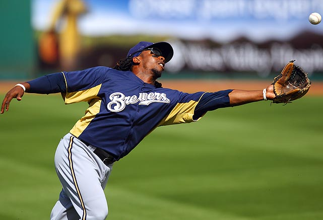 Milwaukee Brewers second baseman Rickie Weeks can't reach a pop-up during a spring training game between the Brewers and Indians in Goodyear, Ariz.  The Indians won 9-7.
