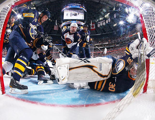 Buffalo's Ryan Miller cowers in goal after making a save during the Sabres' 8-2 victory over the Atlanta Thrashers.