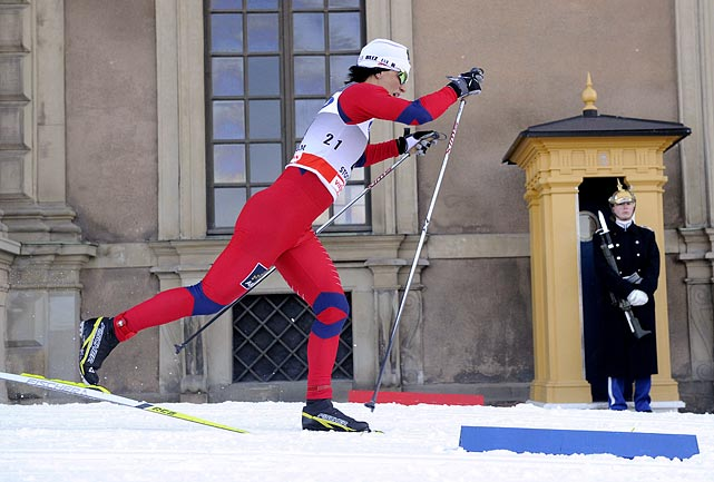 Norway's Marit Bjorgen skis past the royal palace honor guard during the qualification race of the ladies World Cup royal palace sprint in Stockholm.