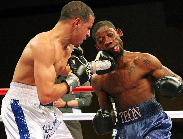 Teon Kennedy takes a nasty left hook from Jorge Diaz during their USBA super bantamweight bout in Atlantic City, N.J.  Despite the shot, Kennedy won by unanimous decision.