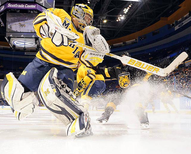 Sports Illustrated 's David Klutho captures a wave of ice shavings during Michigan's 2-1 defeat of Colorado College in the NCAA West Regional Final.