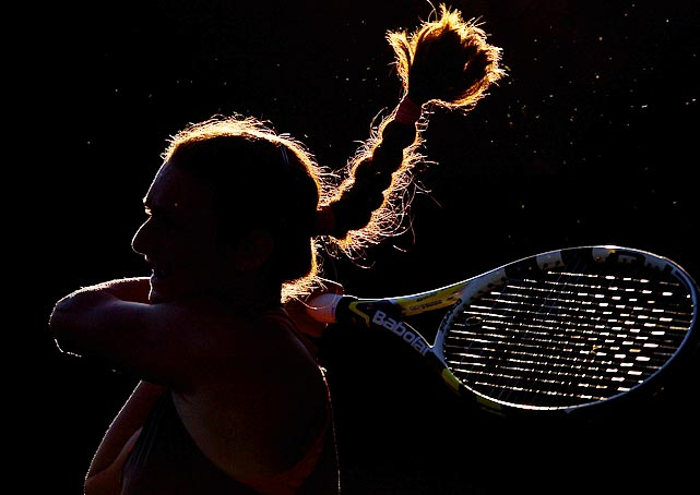 A shrouded Vesna Manasieva follows through on a return against Timea Bacsinszky during the Sony Ericsson Open.