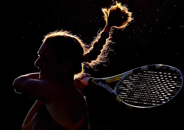 A shrouded Vesna Manasieva follows through on a return against Timea Bacsinszky during the Sony Ericsson Open.